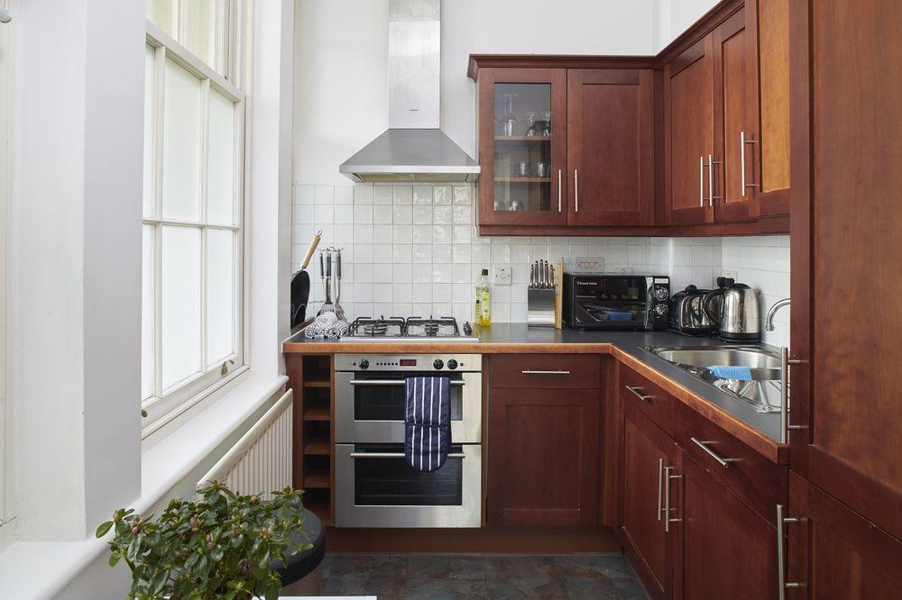 Кухня темного цвета: фото примеры, идеи оформления, полезные рекомендации